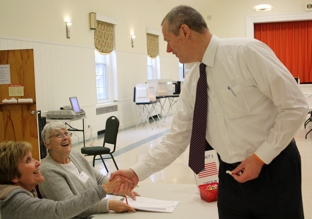 Swampscott, Ma. 4-25-17. Dottie Kitoski, left, and Corinne Mannetta, right, say high to Governor Charlie Baker after he voted at the first Church Congregational in Swampscott today.