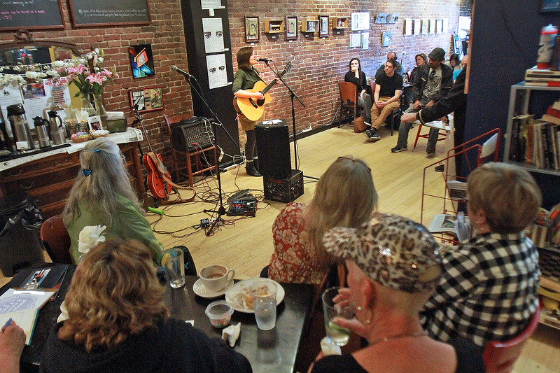Rachel Marie gets the crowds attention in the finals of T-Max's Mic-O-Thon solo singer-songwriter competition Sunday, April 23, at the White Rose Coffeehouse. [Photo / Nicole Goodhue Boyd]
