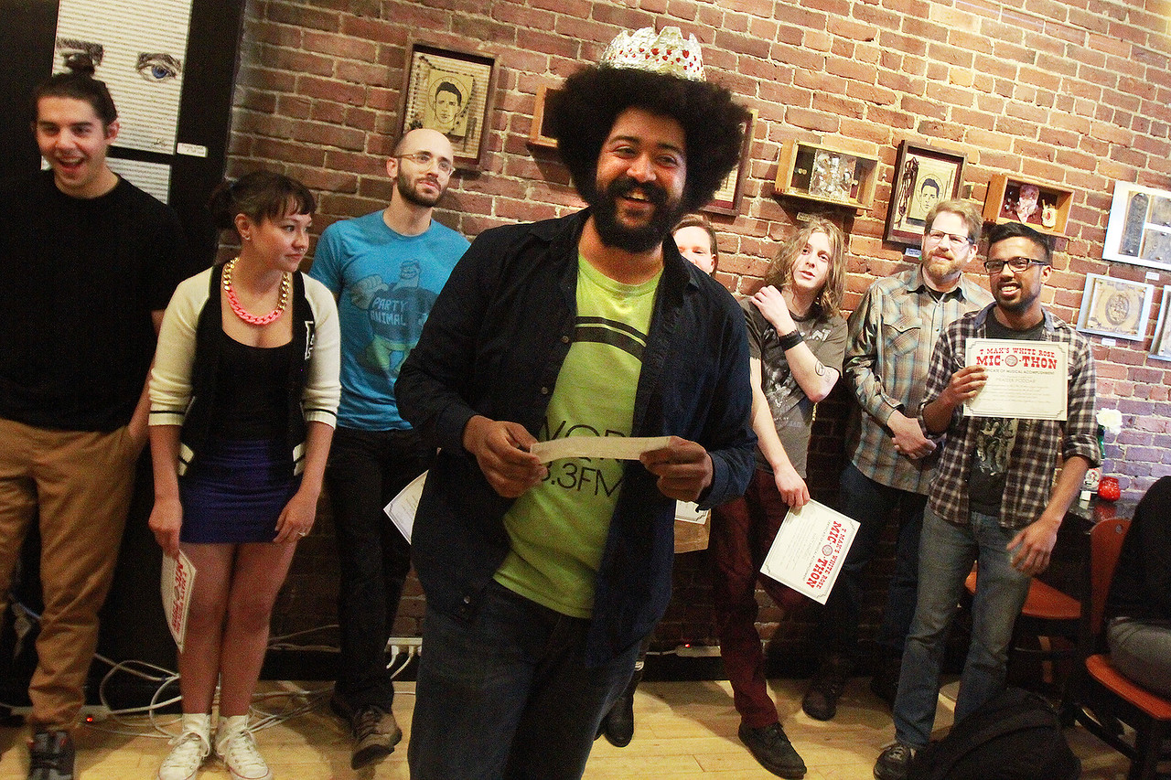 Zion Rodman is all smiles as he is the winner of the $500 prize in the finals of T-Max's Mic-O-Thon solo singer-songwriter competition Sunday, April 23, at the White Rose Coffeehouse. [Photo / Nicole Goodhue Boyd]