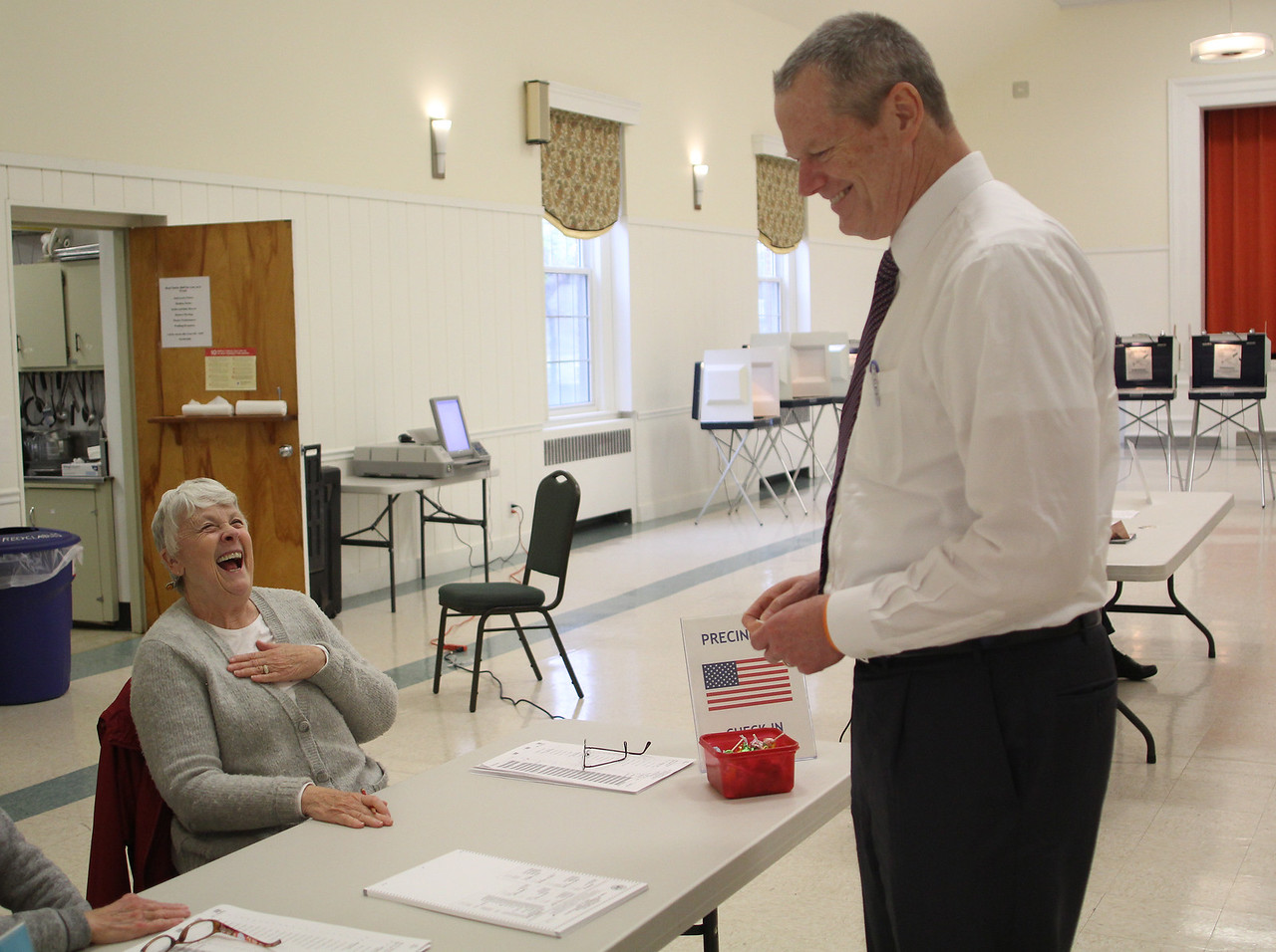 Swampscott, Ma. 4-25-17. Governor Charlie Baker jokes with pole worker Corinne Mannetta as he checks out after voting today at the First Church Congregational in Swampscott.