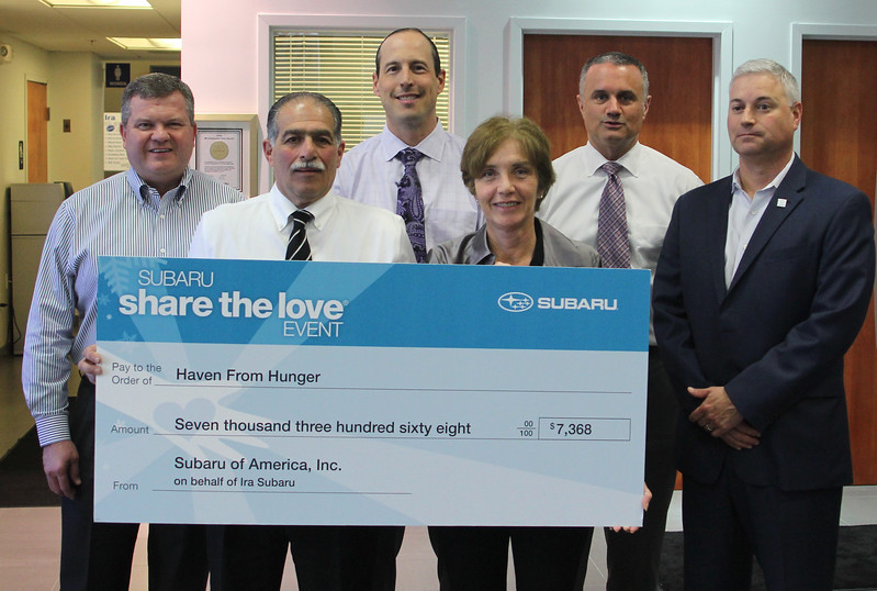 Danvers, Ma. 4-26-17. Members of  Ira Suburu Route 114 in Danvers donate seven thousand dollars to Haven from Hunger. In photo back row left: David Fesmire, Tony DiBenedetto, John Hartman, and Joe Altavilla. Front row left: Michael Garabedian, owner of Ira Suburu, and Anne Strong, from Haven From Hunger.