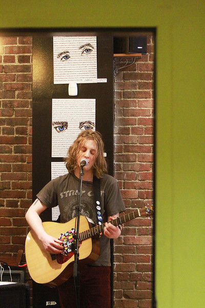 Matt Minigell sings an original he wrote while watching people at a motel in the finals of T-Max's Mic-O-Thon solo singer-songwriter competition Sunday, April 23, at the White Rose Coffeehouse. [Photo / Nicole Goodhue Boyd]