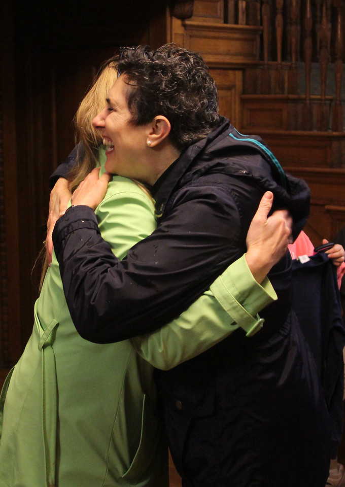 Swampscott, Ma. 4-25-17. Laura Spathanas and Naomi Dreeben hug in Swampscott Town hall after hearing that they were re-elected in uncontested races for selectman.