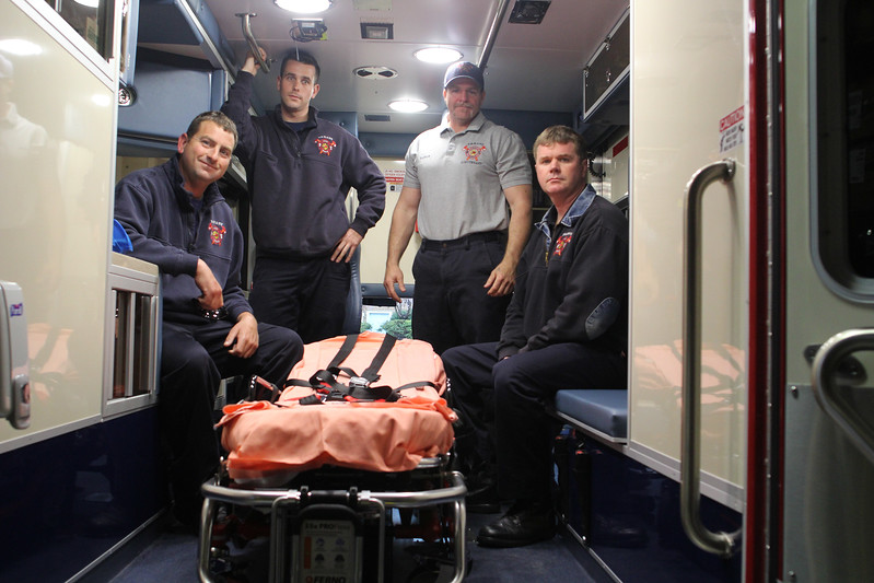Nahant, Ma. 4-25-17. Members of the Nahant Fire Department in the back of the company ambulance are from left to right: Josh Mahoney, Nick Papagelis, Lieutenant Dave Doyle, and Austin Antrim. they feel strongly that the Finance Committee is inaccurate with information it is providing Town Meeting on an article presented by the chief for the creation of an Anbulance Enterprise Fund.