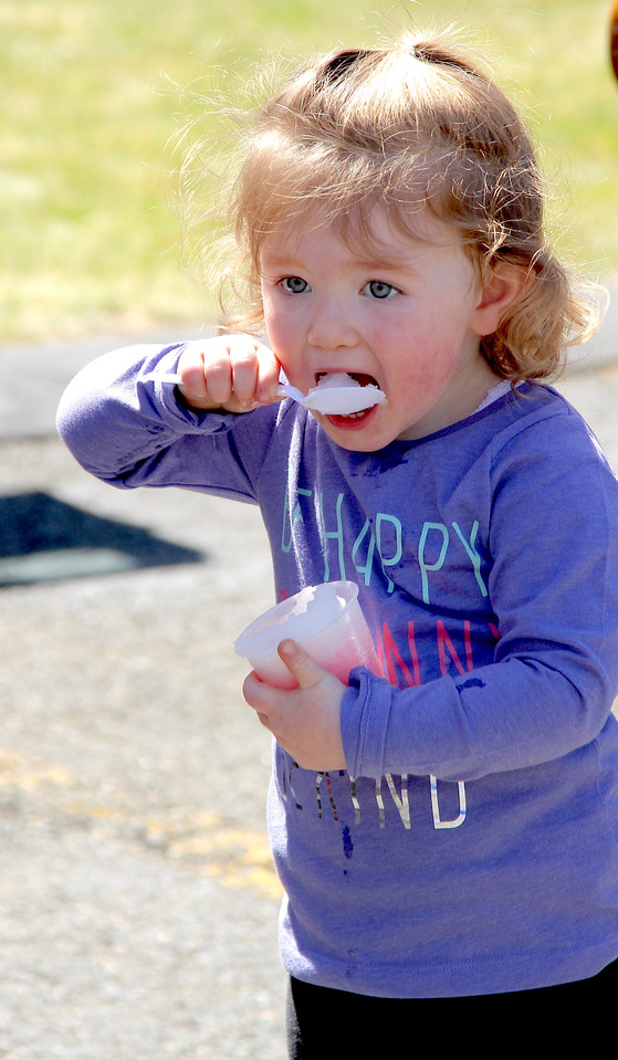 Peabody Mass.  April 23 2017; touch a truck. Noelle Shirley of Peabody takes a spoonful of ice before it melts. BOB ROCHE