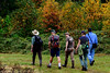 Patrons of the Spring Creek Nature Trail enjoy an early morning walk among the fall colors.