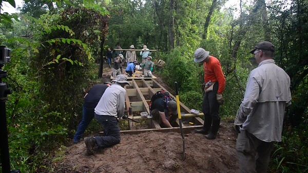 Bayou Land Conservancy Trail Crew volunteers construct the 29 foot long Kahney's Crossing bridge along Spring Creek Nature Trail. This is just 1 of over 20 bridges constucted by the all volunteer crew.