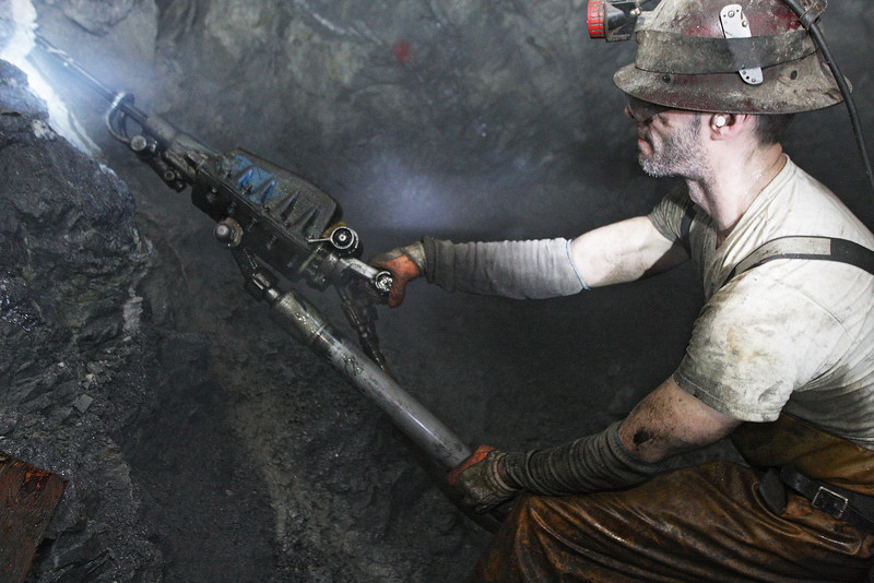 Miner Perry Stack drills a hole using a jack leg to place a bolt and mat for reinforcement of a lead silver tunnel wall at the 2400 foot level at the Galena Mine, in Wallace, Idaho on Wednesday January 4, 2012. (Young Kwak Special to the Pacific Northwest Inlander)