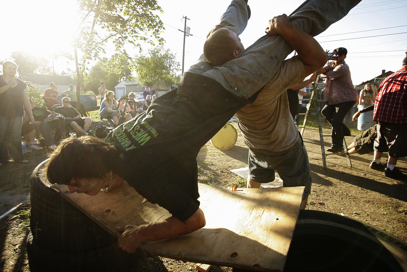 "Jesse ""Shadow"" Boyer, right, throws Gary ""Zilla"" McKay onto plywood during the 6 Man Iron Match, a part of Spokane Anarchy Wrestling's Wrestle Rave 4 at a private residence in Spokane, Wash. on Saturday, June 26, 2010. (Young Kwak Special to the Pacific Northwest Inlander)"