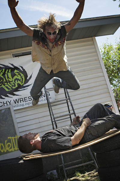 "John ""Crazy"" Jay Ryken, top, jumps on Mike ""Porno Mike"" Brown during Spokane Anarchy Wrestling's Wrestle Rave 4 at a private residence in Spokane, Wash. on Saturday, June 26, 2010. (Young Kwak Special to the Pacific Northwest Inlander)"