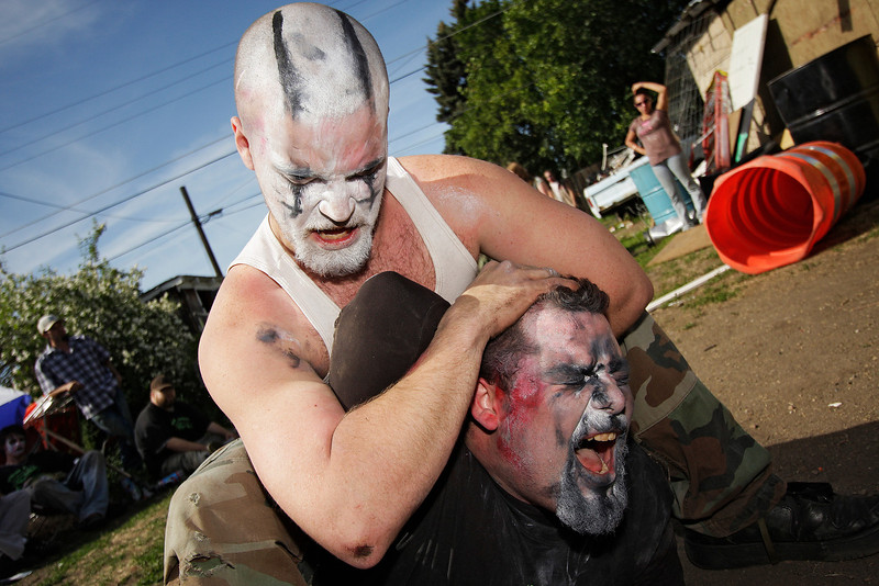 "Robby ""Mayhem"" Williams, top, puts John ""Chaos"" Bacon in a headlock during Spokane Anarchy Wrestling's Wrestle Rave 4 at a private residence in Spokane, Wash. on Saturday, June 26, 2010. (Young Kwak Special to the Pacific Northwest Inlander)"