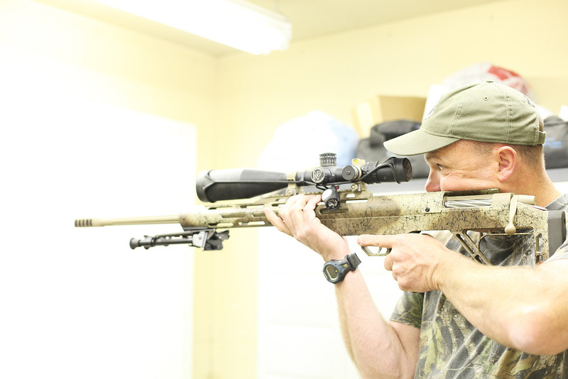 Owner Shawn Carlock holds a prototype 338 Edge, at Defensive Edge, in Rathdrum, Idaho, on Tuesday, May 1, 2012. (Young Kwak/The Pacific Northwest Inlander)