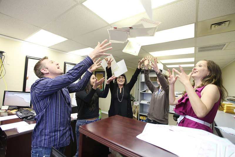 (Left to right) CEO Rick Piezconka, Order Fulfillment Ashley Akizawa, Operations Manager Jennifer Fuson, Designer Lindsay McCart and President Heather Pieczonka throw games up in the air at Funsational!, in Spokane Valley, Wash., on Thursday, May 3, 2012. (Young Kwak/The Pacific Northwest Inlander)