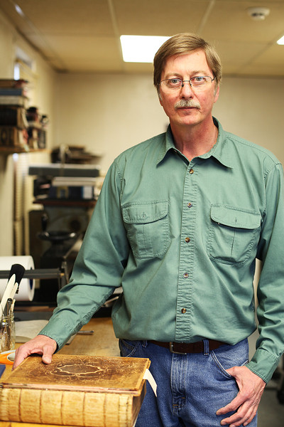 Owner Willem Bosch poses for a photograph at Arts & Crafts Book Manufacturing Co., in Spokane, Wash., on Thursday, April 26, 2012. (Young Kwak/The Pacific Northwest Inlander)