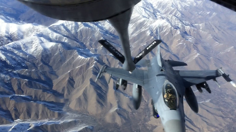An F-16 refuels from a 376th Expeditionary Operations Group KC-135 during a mission over Afghanistan, on Saturday, Dec. 14, 2013. (Young Kwak/The Pacific Northwest Inlander)