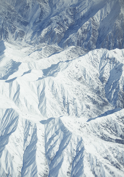 The Hindu Kush Mountains are photographed from a KC-135 during the 376th Expeditionary Operations Group Shell 74, a refueling mission over Afghanistan, on Saturday, Dec. 14, 2013. (Young Kwak/The Pacific Northwest Inlander)