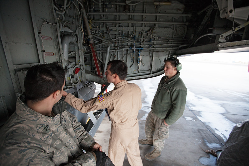 376th Expeditionary Operations Group Captain Mike Dobbs, center, checks the wheel well of KC-135 as 376th Expeditionary Aircraft Maintenance Squadron Senior Airman Nick Stevens, left, and Airman First Class Joshua Jones look on, at the Transit Center at Manas, Kyrgyzstan, on Sunday, December 15, 2013. Captain Mike Dobbs's home unit is the 92nd Air Refueling Squadron, Senior Airman Nick Stevens' home unit is 92nd Aircraft Maintenance Squadron, while Airman First Class Joshua Jones's home unit is the 92nd Maintenance Squadron. Both are based out of Fairchild Air Force Base, Wash. (Young Kwak/The Pacific Northwest Inlander)