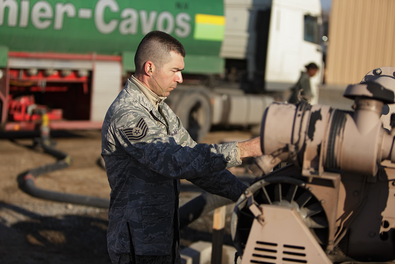 376th Expeditionary Logistics Readiness Squadron Technical Sergeant Nick Parrott starts up a R22 pumping unit to move diesel fuel from a truck to a large bladder, at the Transit Center at Manas, Kyrgyzstan, on Friday, Dec. 13, 2013.  Parrot's home unit is the 92nd Logistics Readiness Squadron, based out of Fairchild Air Force Base, Wash.(Young Kwak/The Pacific Northwest Inlander)