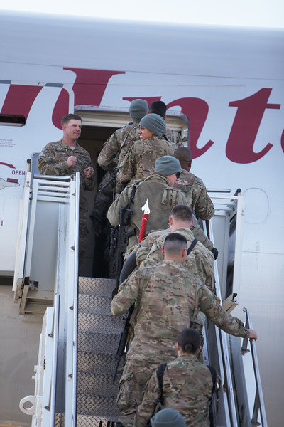 US military service members returning from combat deployment in Afghanistan board an Omni Air International 777 for a flight home, at the Transit Center at Manas, Kyrgyzstan, on Friday, Dec. 13, 2013. (Young Kwak/The Pacific Northwest Inlander)