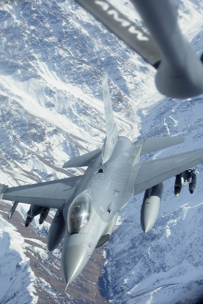 An F-16 separates from a 376th Expeditionary Operations Group KC-135 during a refueling mission over Afghanistan, on Saturday, Dec. 14, 2013. (Young Kwak/The Pacific Northwest Inlander)