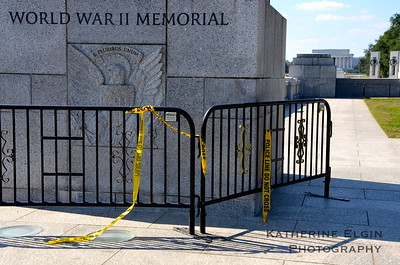 The World War II Memorial is barricaded by fencing and police warning tape.