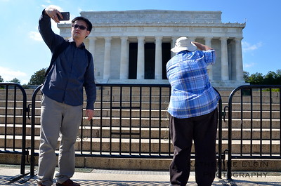 Tourists take photographs of the Lincoln Memorial from the closest distance they can reach—the bottom of the famous steps.