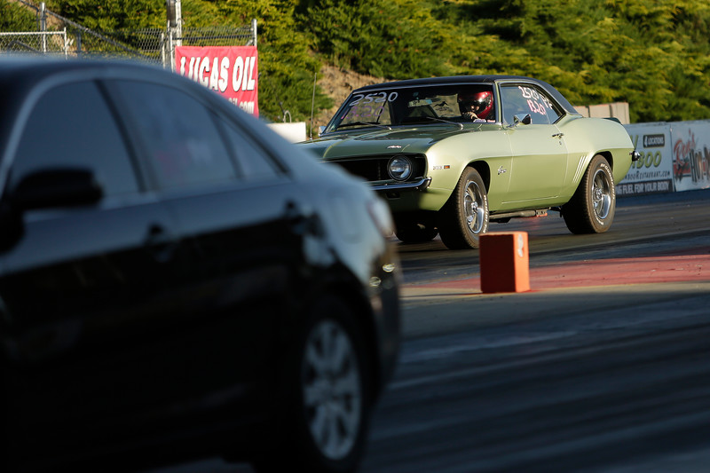 Miss Shifters Treasurer Annette Callesto sits in her 1969 Chevrolet Camaro before the first Powder Puff elimination round, during the Summit #6 Sugar Bear Memorial at the Spokane County Raceway in Airway Heights, Wash., Saturday, July 14, 2018. (Young Kwak/The Inlander)