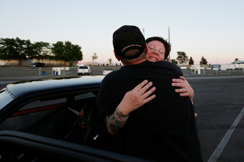 Miss Shifters President Rachelle Stephens, right, hugs her husband Casey Stephens after she lost in the third Powder Puff elimination round, during the Summit #6 Sugar Bear Memorial at the Spokane County Raceway in Airway Heights, Wash., Saturday, July 14, 2018. (Young Kwak/The Inlander)