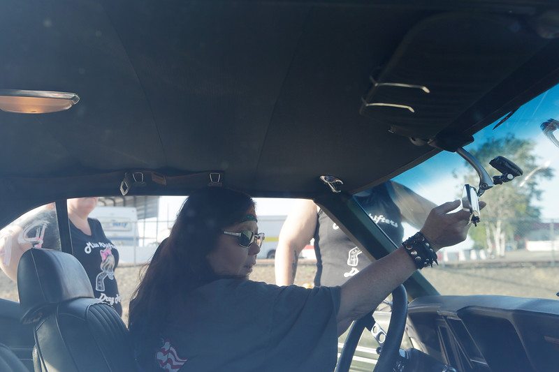 Miss Shifters Treasurer Annette Callesto sits in her 1969 Chevrolet Camaro before a Powder Puff time trial, during the Summit #6 Sugar Bear Memorial at the Spokane County Raceway in Airway Heights, Wash., Saturday, July 14, 2018. (Young Kwak/The Inlander)