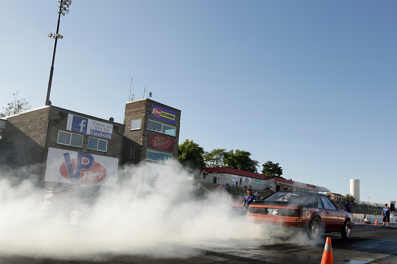 Miss Shifters President Rachelle Stephens does a burnout in her 1984 Ford Mustang GT before a Powder Puff time trial, during the Summit #6 Sugar Bear Memorial at the Spokane County Raceway in Airway Heights, Wash., Saturday, July 14, 2018. (Young Kwak/The Inlander)
