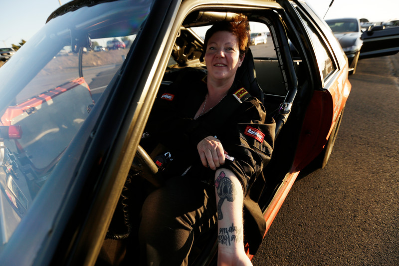 Miss Shifters President Rachelle Stephens shows her club logo tattoo while sitting in her 1984 Ford Mustang GT, before the second Powder Puff elimination round, during the Summit #6 Sugar Bear Memorial at the Spokane County Raceway in Airway Heights, Wash., Saturday, July 14, 2018. (Young Kwak/The Inlander)
