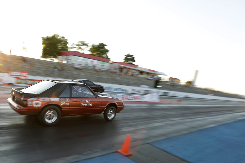 Miss Shifters President Rachelle Stephens, left, drives her 1984 Ford Mustang GT in the second Powder Puff elimination round, during the Summit #6 Sugar Bear Memorial at the Spokane County Raceway in Airway Heights, Wash., Saturday, July 14, 2018. (Young Kwak/The Inlander)