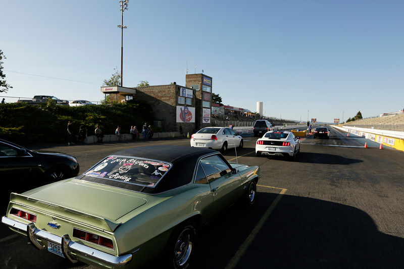 Miss Shifters Treasurer Annette Callesto sits in her 1969 Chevrolet Camaro while waiting in line for a Powder Puff time trial, during the Summit #6 Sugar Bear Memorial at the Spokane County Raceway in Airway Heights, Wash., Saturday, July 14, 2018. (Young Kwak/The Inlander)