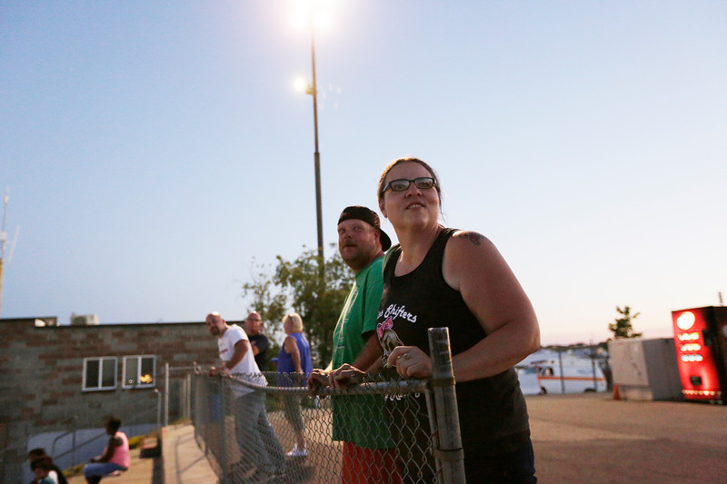 Miss Shifters Heather Eller, right, and her husband Cody Eller watch a race, during the Summit #6 Sugar Bear Memorial at the Spokane County Raceway in Airway Heights, Wash., Saturday, July 14, 2018. (Young Kwak/The Inlander)