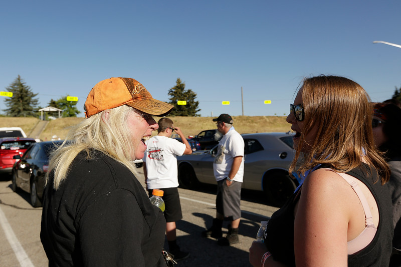 Miss Shifters members Angie Weaver, left, and Jessica Boller speak before a Powder Puff time trial, during the Summit #6 Sugar Bear Memorial at the Spokane County Raceway in Airway Heights, Wash., Saturday, July 14, 2018. (Young Kwak/The Inlander)