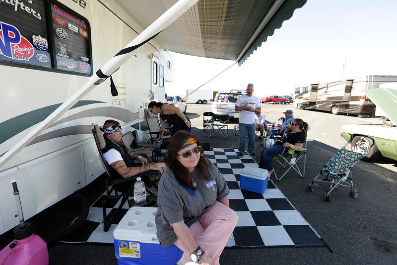 Miss Shifters Treasurer Annette Callesto, front, sits in the pit area before racing, during the Summit #6 Sugar Bear Memorial at the Spokane County Raceway in Airway Heights, Wash., Saturday, July 14, 2018. (Young Kwak/The Inlander)