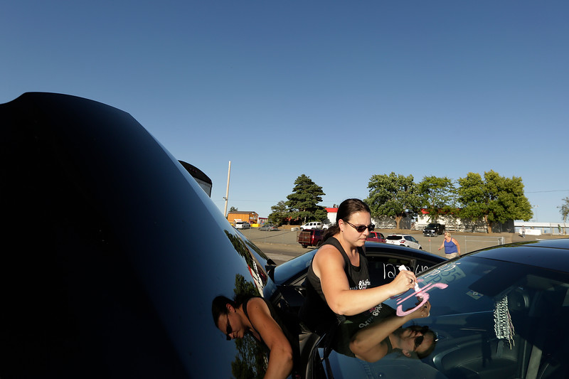 Miss Shifters member Heather Eller writes her dial-in time on her 2011 Buick Regal Turbo before the first Powder Puff elimination round, during the Summit #6 Sugar Bear Memorial at the Spokane County Raceway in Airway Heights, Wash., Saturday, July 14, 2018. (Young Kwak/The Inlander)