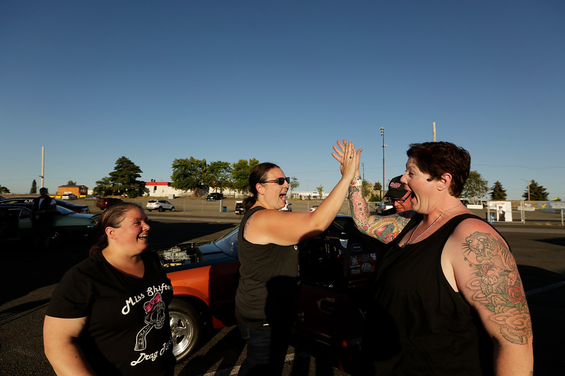 President Rachelle Stephens, right, celebrates with members Shelly Walsh, left, and Heather Eller after each advanced to the second Powder Puff elimination round, during the Summit #6 Sugar Bear Memorial at the Spokane County Raceway in Airway Heights, Wash., Saturday, July 14, 2018. (Young Kwak/The Inlander)