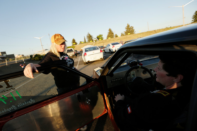 Miss Shifters member Angie Weaver, left, speaks with President Rachelle Stephens, who is sitting in her 1984 Ford Mustang GT, before the second Powder Puff elimination round, during the Summit #6 Sugar Bear Memorial at the Spokane County Raceway in Airway Heights, Wash., Saturday, July 14, 2018. (Young Kwak/The Inlander)