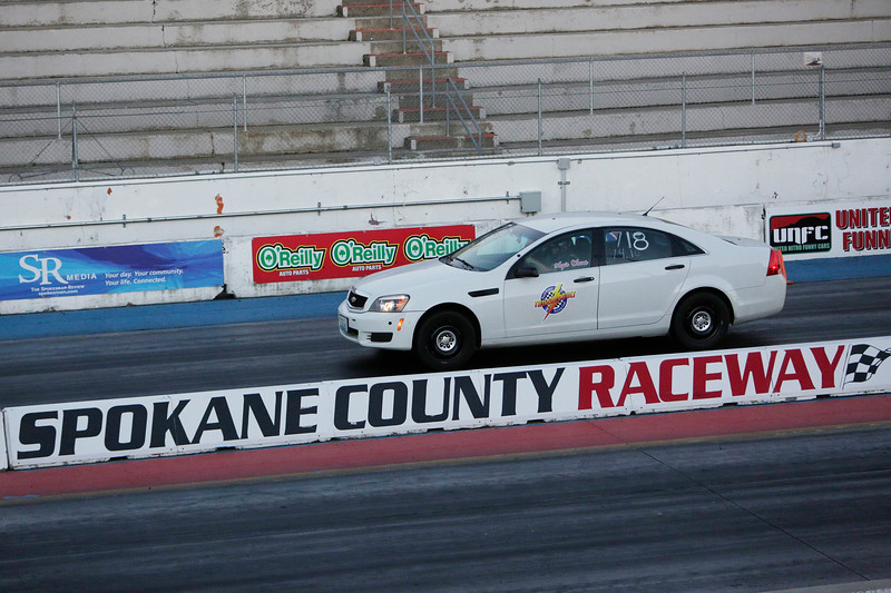 Miss Shifters Angie Weaver drives her 2013 Chevrolet Caprice Police Interceptor in the final Powder Puff elimination round, which she lost, during the Summit #6 Sugar Bear Memorial at the Spokane County Raceway in Airway Heights, Wash., Saturday, July 14, 2018. (Young Kwak/The Inlander)