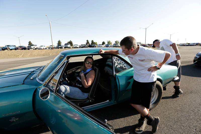 Miss Shifters member Jessica Boller, left, sits in her 1967 Chevrolet Camaro while speaking with her 16 year old son Dylan Boller, before a Powder Puff time trial, during the Summit #6 Sugar Bear Memorial at the Spokane County Raceway in Airway Heights, Wash., Saturday, July 14, 2018. (Young Kwak/The Inlander)