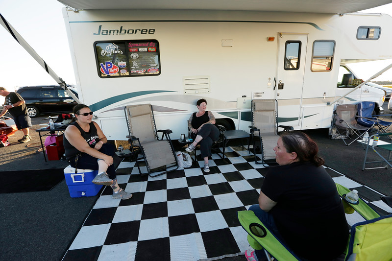 Miss Shifters member Heather Eller, President Rachelle Stephens and member Shelly Walsh speak in the pit area before the second Powder Puff elimination round, during the Summit #6 Sugar Bear Memorial at the Spokane County Raceway in Airway Heights, Wash., Saturday, July 14, 2018. (Young Kwak/The Inlander)