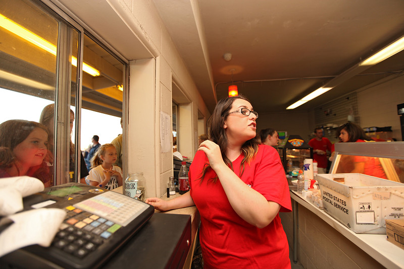Employee Julia Grier repeats an order at the concession stand at the Spokane County Raceway oval track, in Airway Heights, Wash., on Saturday, August 25, 2012. (Young Kwak/The Pacific Northwest Inlander)