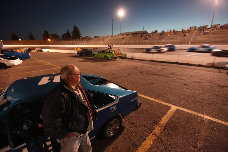 79 year old Roadrunner 1984 Toyota Celica Owner Dan Ortiz watches a Pony Class Trophy Dash race at the Spokane County Raceway oval racetrack, in Airway Heights, Wash., on Friday, August 24, 2012. Ortiz, a  Post Falls, Idaho resident, began driving race cars when he became 69 years old. (Young Kwak/The Pacific Northwest Inlander)
