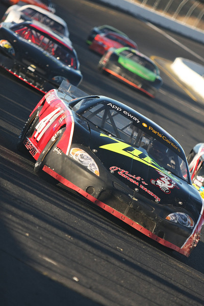 Andy Brown (41) and other drivers race a heat before the Spokane 200, at the Spokane County Raceway oval track, in Airway Heights, Wash., on Saturday, August 25, 2012. (Young Kwak/The Pacific Northwest Inlander)