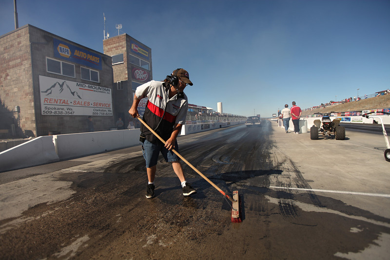 Taping Crew member Tim Harmon cleans the burnout area before a race at the Spokane County Raceway drag strip, in Airway Heights, Wash., on Saturday, August 25, 2012. (Young Kwak/The Pacific Northwest Inlander)