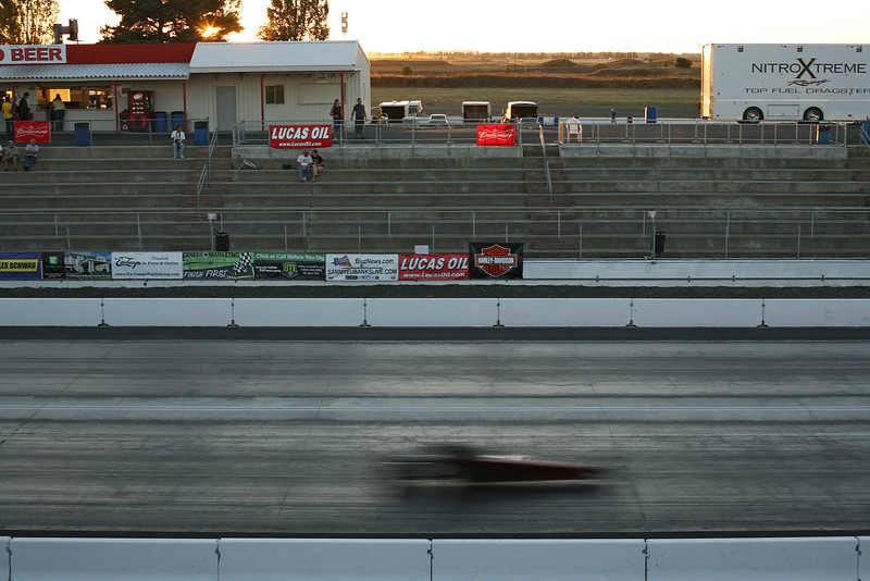 A Junior Dragster races by at the Spokane County Raceway drag strip, in Airway Heights, Wash., on Saturday, August 25, 2012. (Young Kwak/The Pacific Northwest Inlander)