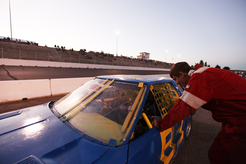 Roadrunner Class Driver 19 year old Ben Cramer, right, speaks with his father Kevin Cramer, who drives a Nissan 200SX at the Spokane County Raceway oval racetrack, in Airway Heights, Wash., on Friday, August 24, 2012. (Young Kwak/The Pacific Northwest Inlander)