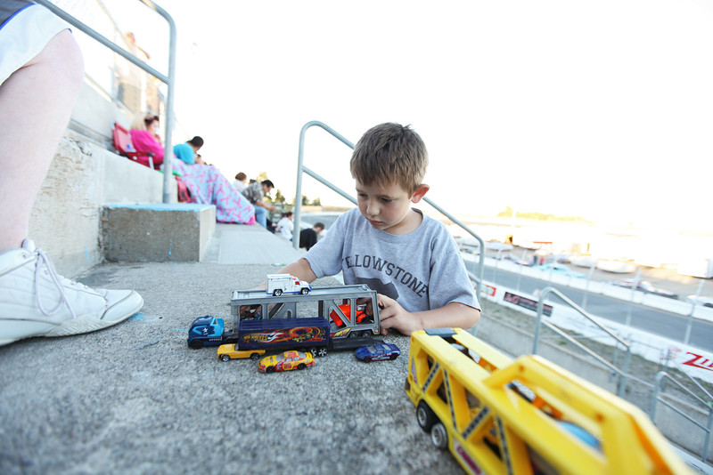8 year old Zachary Kness plays with his toy cars at the oval racetrack, at the Spokane County Raceway, in Airway Heights, Wash., on Friday, August 24, 2012. (Young Kwak/The Pacific Northwest Inlander)