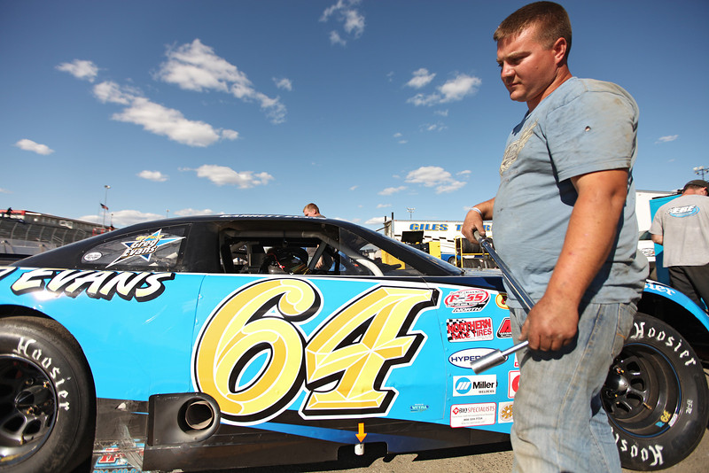 Quincy, Wash. resident and Crew Member Mike Knutson prepares to tighten bolts on East Wenatchee Driver Garrett Evans', not pictured, Late Model Class car at the Spokane County Raceway oval racetrack, in Airway Heights, Wash., on Friday, August 24, 2012. The vehicle runs a Hamke Chassis with a Maropulis Chevy V8. (Young Kwak/The Pacific Northwest Inlander)